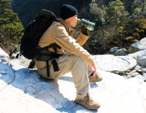 Hiking Man Drinks Purified Water
